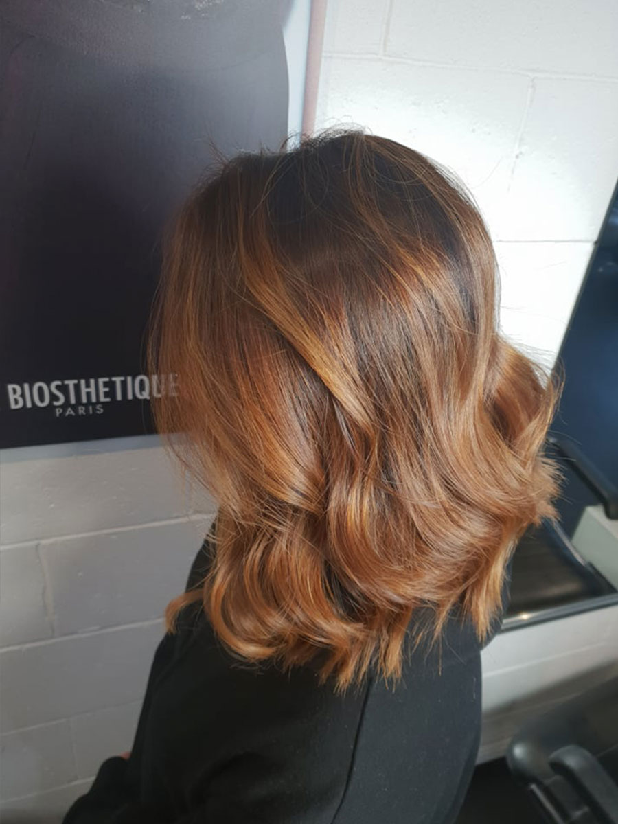 Brunette with golden red highlights