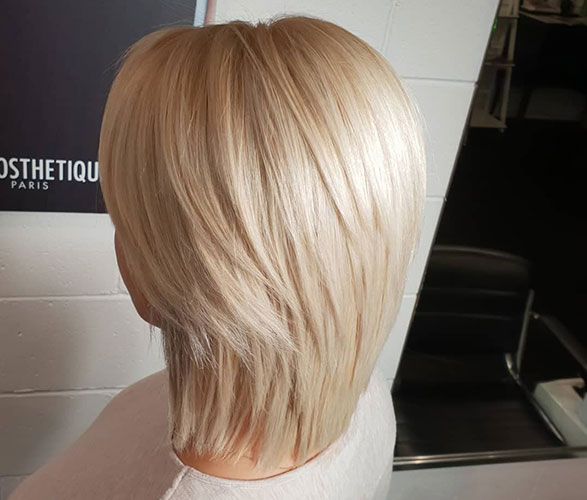 Beautiful blonde with layered bob cut